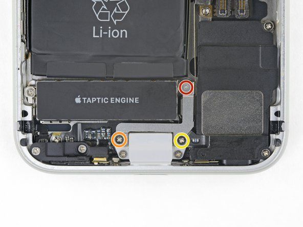 Remove the three screws securing the bracket next to the Taptic Engine: