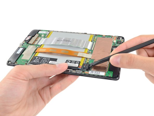 Image 1/2: Seals cover two of the screws in the Nexus 7—one on each of the main boards—so replacing either board will likely void your warranty.
