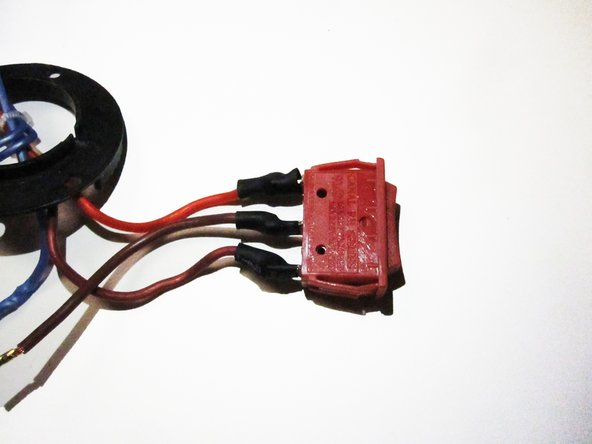 Remove the black, plastic wire protectors from the end of the power switch.