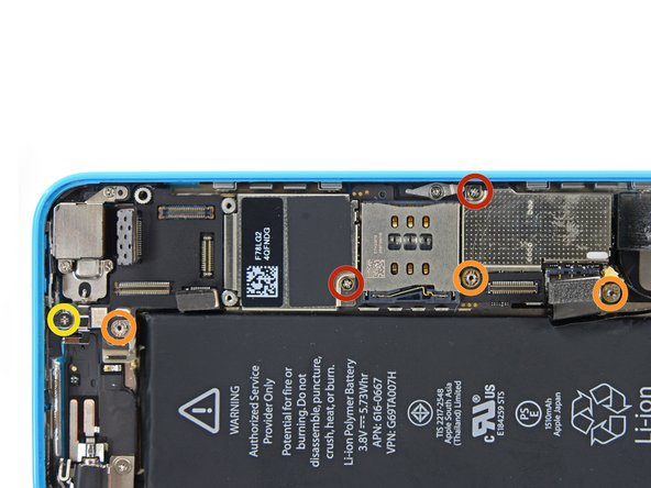 Remove the following screws securing the logic board to the rear case:
