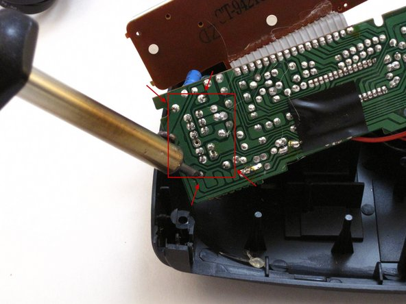 Image 2/2: Apply the hot soldering iron to those four soldered pins to disconnect the four-position switch.