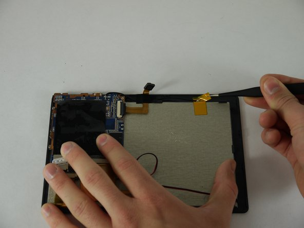 Using a pair of tweezers begin to peel the antenna from the metal panel.