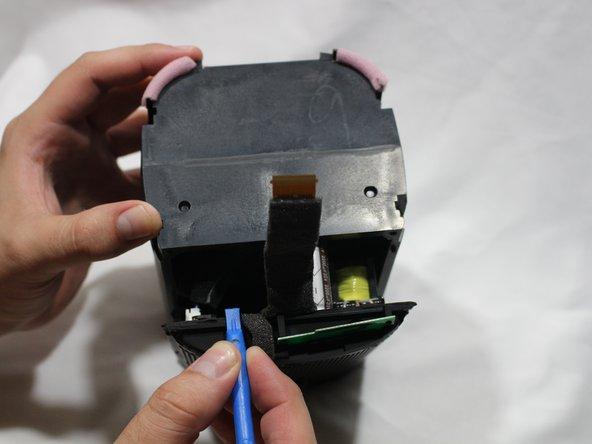 Using a plastic opening tool, separate the processing board from the housing unit.