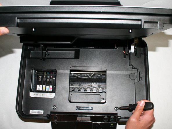 Remove the three size#6 (5-mm head) Phillips 1-mm screws connecting the scanner unit to the printer.