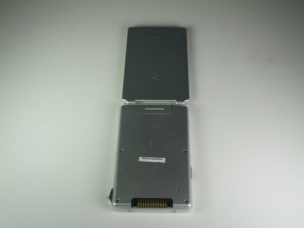 Image 1/2: Notice the tab connecting the flip cover to the back of the PDA.