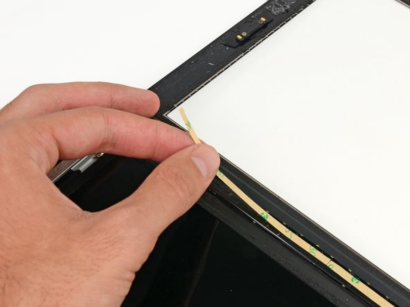 Place the straight adhesive strip on the right side of the front panel.