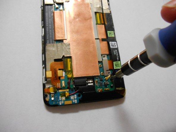 Image 2/3: Remove the screws using a T6 Torx screwdriver.