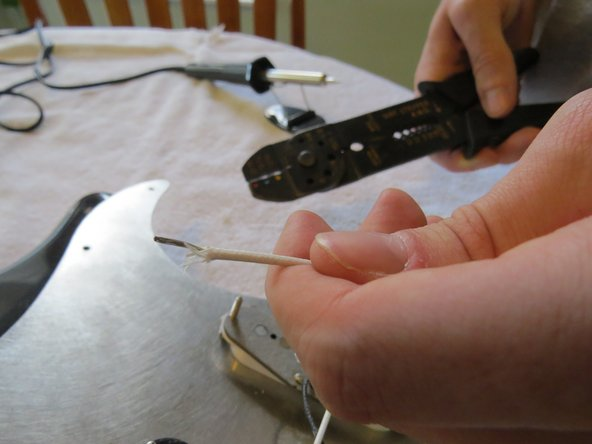 "Use wire cutters to strip about 1/2"" of shielding off the wire."