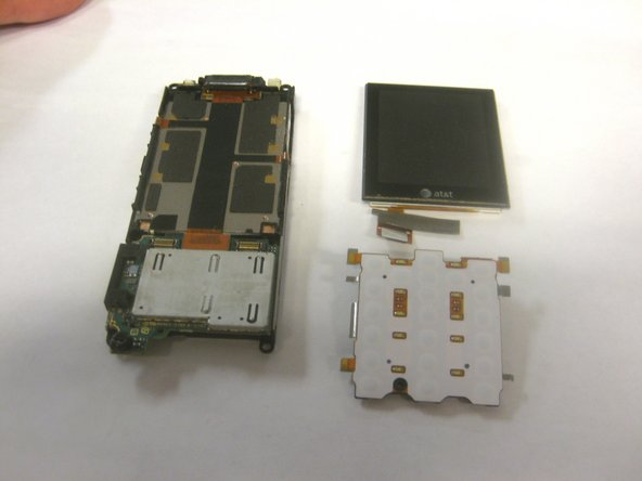 Once the screen and keypad are removed, the assembly of the phone should be as shown in the third picture.