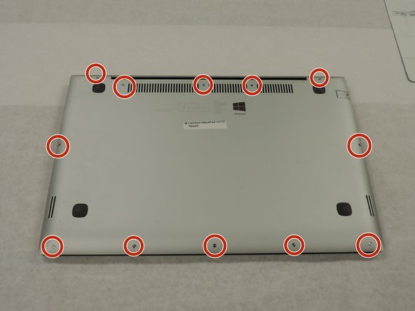 Remove all of the screws on the back panel with a Phillips #000 screwdriver.