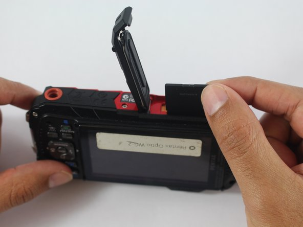 To remove the SD Memory Card, push it in once and then pull it out.
