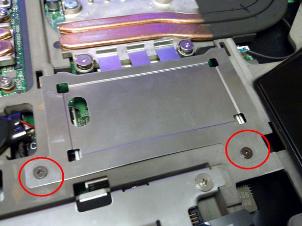 Unscrew the two screws indicated