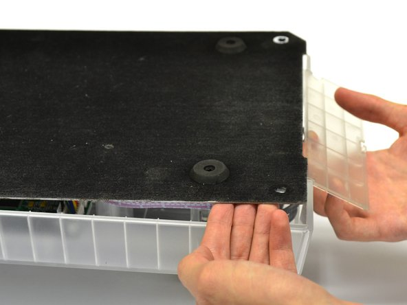 Image 1/1: Reach under the panel and push upwards on the back panel. Lift it up and remove it from the device.