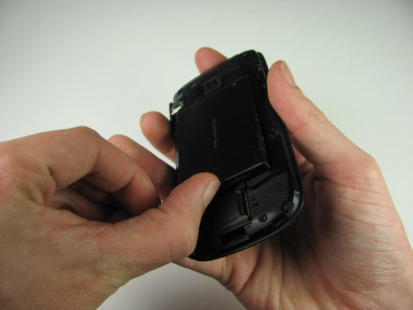 Turn the phone over and remove the battery by using your thumb to push forward on the battery and then lift it.