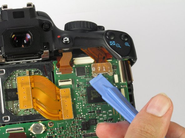 In the upper right corner of the motherboard, use the plastic opening tool to remove the clear cable connector from the motherboard.