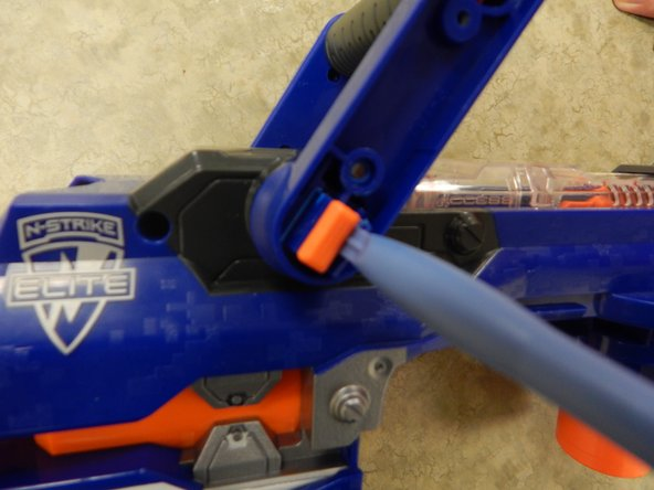Insert one plastic opening tool inside one side of the orange part depicted in the picture.