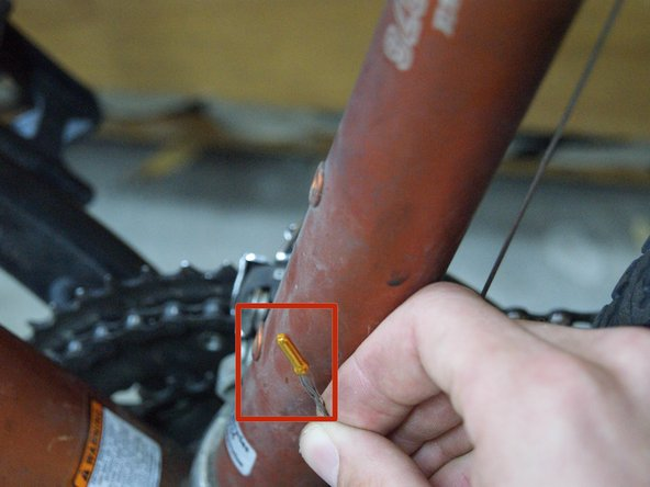 Place the crimp on the cut end of the cable, making sure to get any loose strands within the crimp as well.