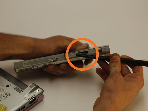 With a soft or medium bristle brush, gently remove debris from the battery's contacts.