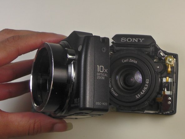 Pry the front cover of the camera off with the plastic opening tool.