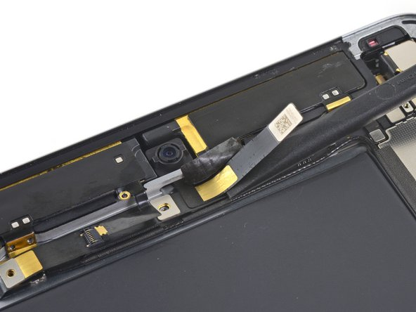 Push back the front-facing camera's ribbon cable to access the headphone jack connector.
