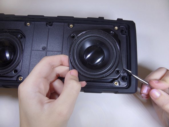 Image 2/3: Remove the speakers with your hands and replace with new ones.
