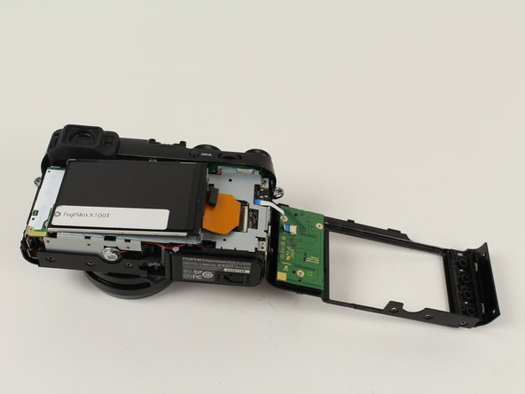 Image 1/3: This separates the LCD from the main board.