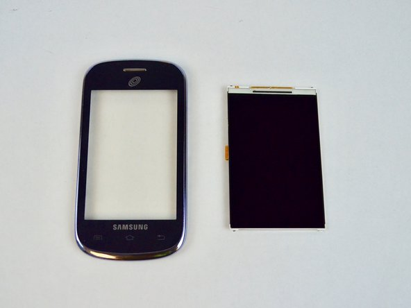 Image 3/3: Gently apply pressure to raise the screen from its held position. Continue pulling gently upwards from one side until the screen has been completely removed.