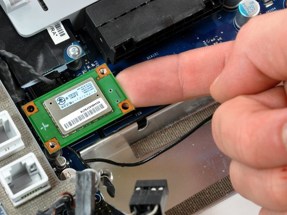 Image 1/2: Use your finger to lift the Bluetooth board from the right edge up off its socket on the logic board.
