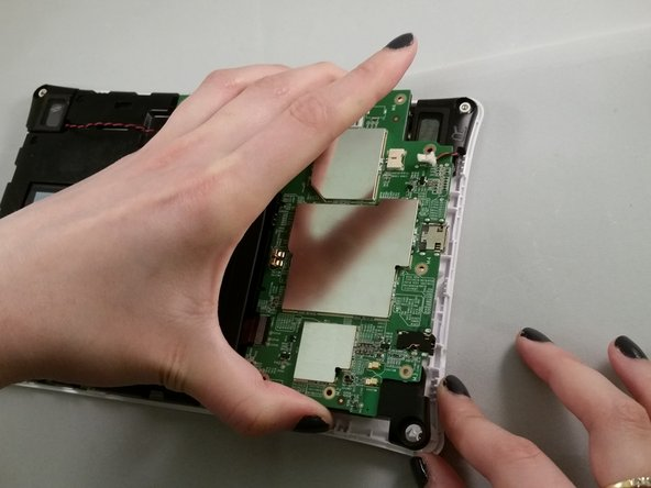Lift the circuit board to get better access for removing the speaker.