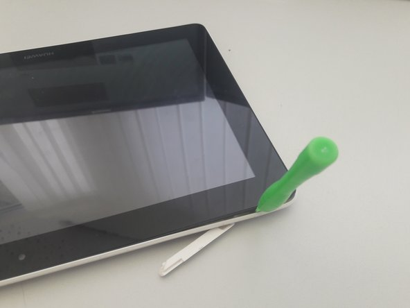 Use a prying tool to loosen the back cover from the display.
