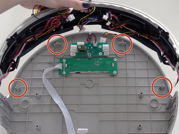 Then line up the bumper up with the screw posts on the lid.