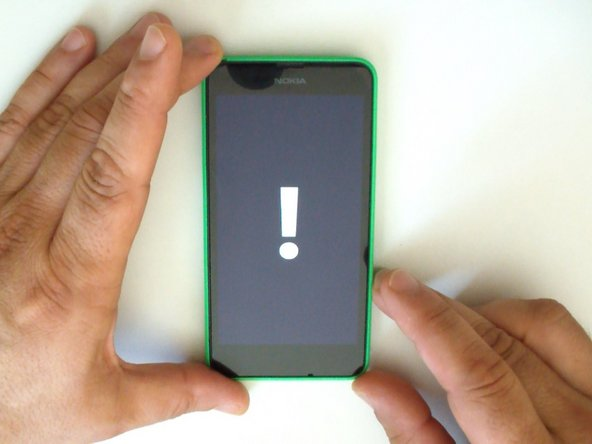 Image 1/3: Press and hold the power button. When the phone vibrates, release it and press and hold the volume down button until you see the exclamation  mark on the screen.
