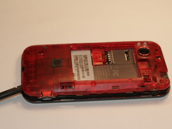 Use the spudger to pry the casing off of the phone.
