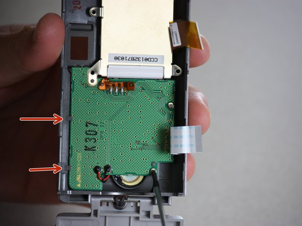 Pull gently, as to not destroy any of the other internal parts of the camera.