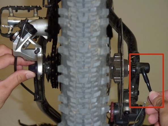 Begin loosening the tire by turning the quick release handle.