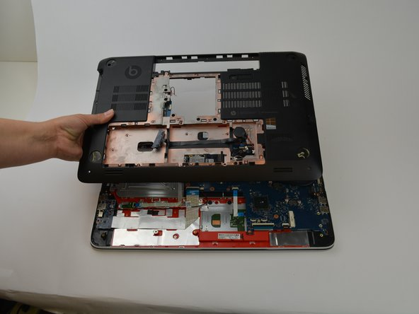 Pull the under panel from the laptop by pulling at the edges once all screws are removed. Gently lift it off and place to the side.