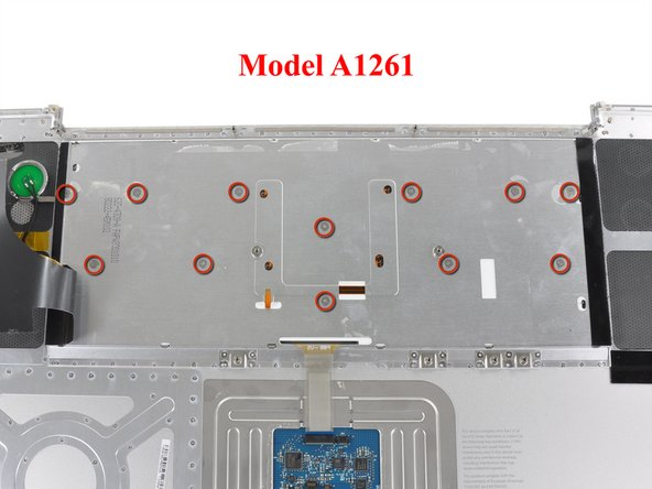 The keyboard on A1261 models is secured with twelve screws. Their locations are shown in the second picture.