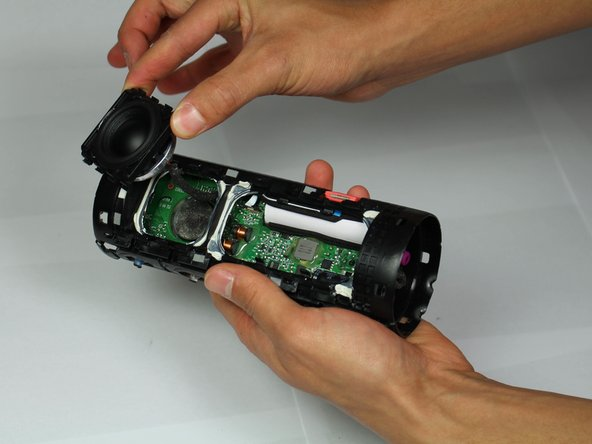 Be sure to remove the speaker slowly, as there is a cable attaching the speaker to the motherboard.
