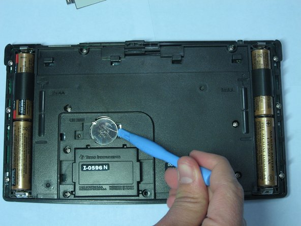 Use an Ipod Opening Tool or a similar tool to pull up on the right side of the backup battery.