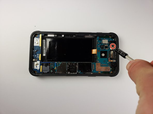 Use a Phillips 000 screwdriver to remove the screw covering the proximity sensor.