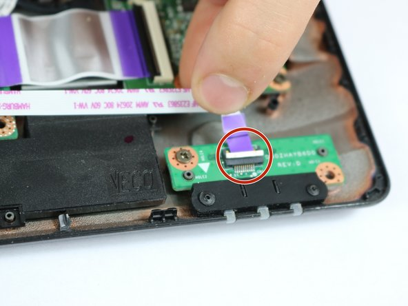 Image 2/2: Remove the indicator light connection by gently pulling the purple tabs away from the locks.