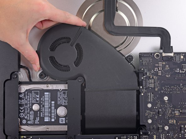 Gently lift the fan up and remove it from the iMac.