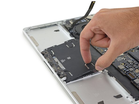 Lift up and remove the trackpad from the upper case.