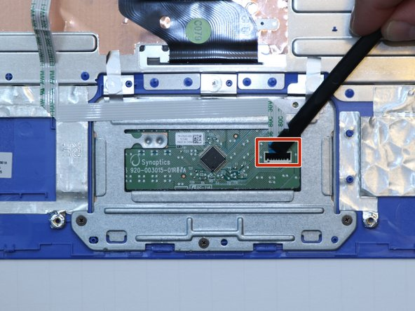 Use a plastic spudger to remove the black, plastic tab holding down the ZIF connector.