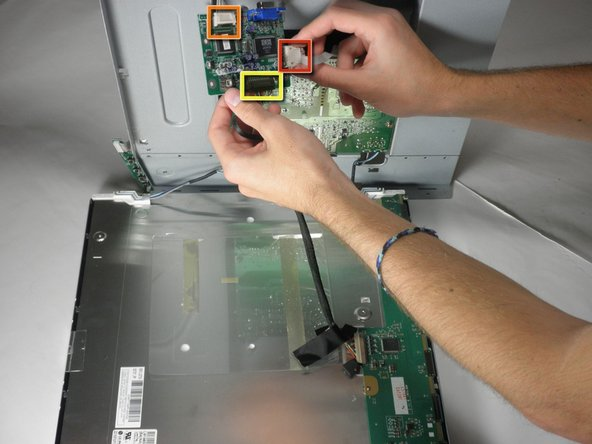 Image 1/2: There is another wire connecting the button board to the inverter board. Remove the second white wire connector.