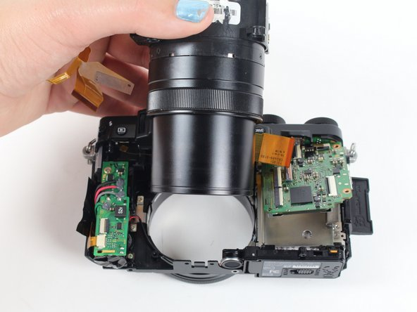 Then push the lens with your index fingers from the front of the camera until it is removed.