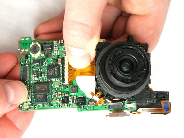 Carefully remove the lens from the motherboard. Use tweezers to remove any of the 4 connecting ribbons from the lens.