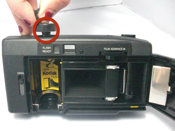 To take out the old film and insert the new, you must lift up on the film roller.