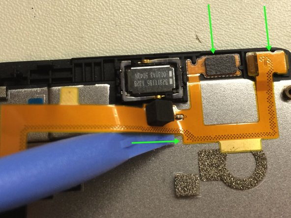 Top two arrows indicate Camera, and chip. Button arrow indicate the way it is easiest to get the cable off.