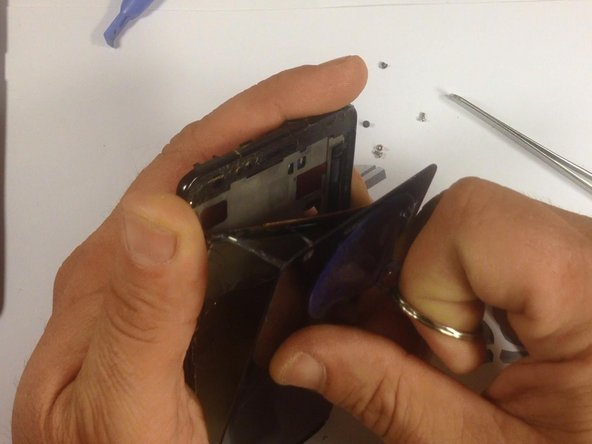 Now, use a suction tool to remove the screen from it's housing. Be careful when doing this, to prevent possible injury.